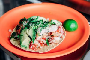 Ceviche on a tostada at a food cart on the Sabores Mexico City food tour.