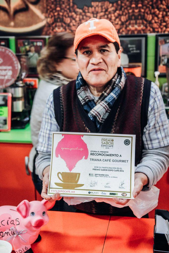 A coffee house owner at the Mercado de San Juan in Mexico City.