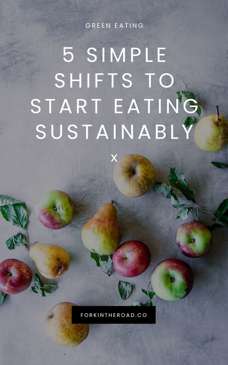 """assorted green, red, and yellow apples on a blue table with the words """"5 simple shifts to start eating sustinably"""" in white writing"""
