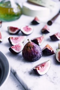 Sliced figs on a cutting board.