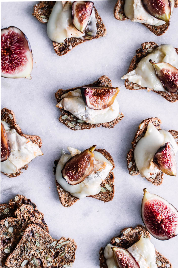 Assorted crostini with brie and figs.