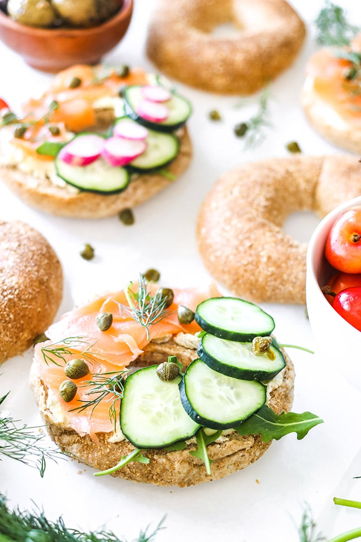 Smoked salmon bagels with cream cheese, dill, capers and all the veggies! Easy recipe for brunch or a weeknight no-cook dinner.