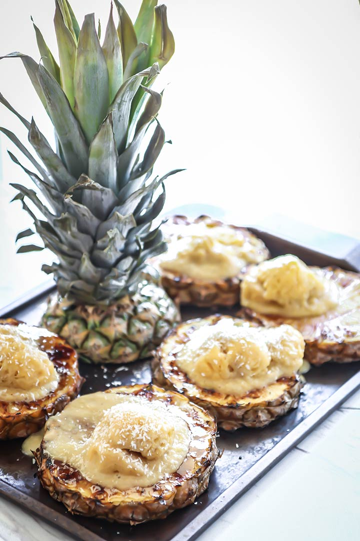 Grilled Pineapple with Mango Banana Nice Cream topped with fresh coconut and a bourbon sauce drizzle, a fresh and tasty tropical summer treat!