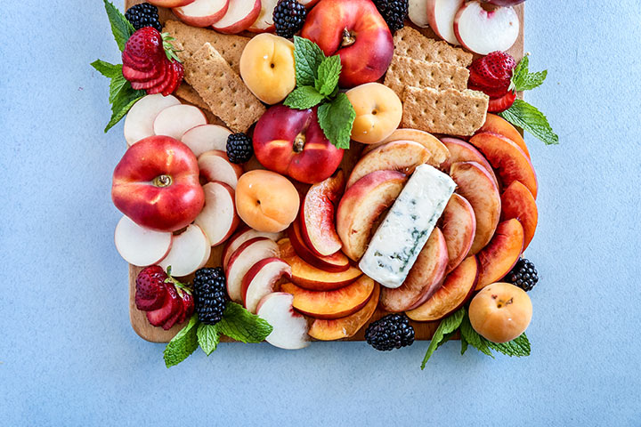 Summer Stone Fruit Cheese Platter, a summer fruit spread of peaches, nectarines and apricots with strong blue cheese and wildflower honey.