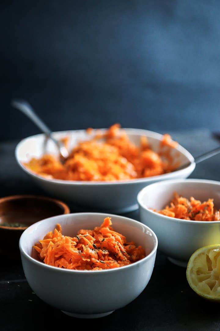 Honey Citrus Carrot Salad, a fresh, seasonal side dish or salad topper made fresh shredded carrots and a homemade honey citrus thyme dressing.