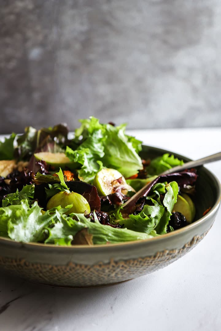 Autumn Apple Fig Barley Bowl, the perfect plant-based fall salad of barley, mixed greens, sliced apples, dried cranberries and a light cashew dressing.