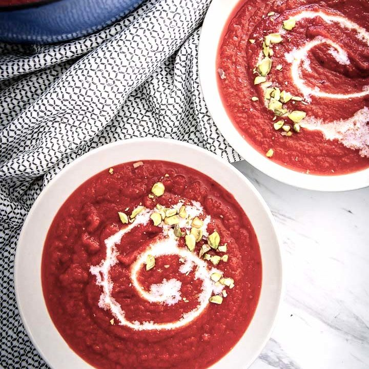 Red Beet Apple Soup, a delicious soup of red beets, fresh fall apples, celery, and herbs that will keep you warm and cozy on cold weather nights.