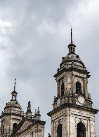 The top of the tower of the Bogota Cathedral with a grey blue sky in the background.