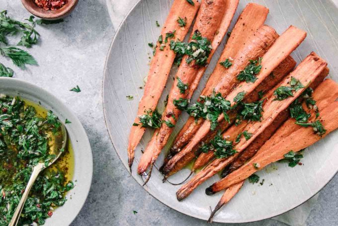 chimichurri drizzled over roasted carrots