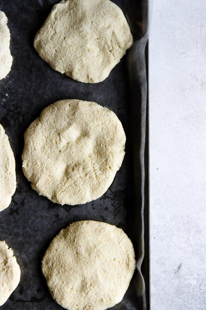 Colombian spicy vegetable arepas recipe dough before cooking on a dark pan.
