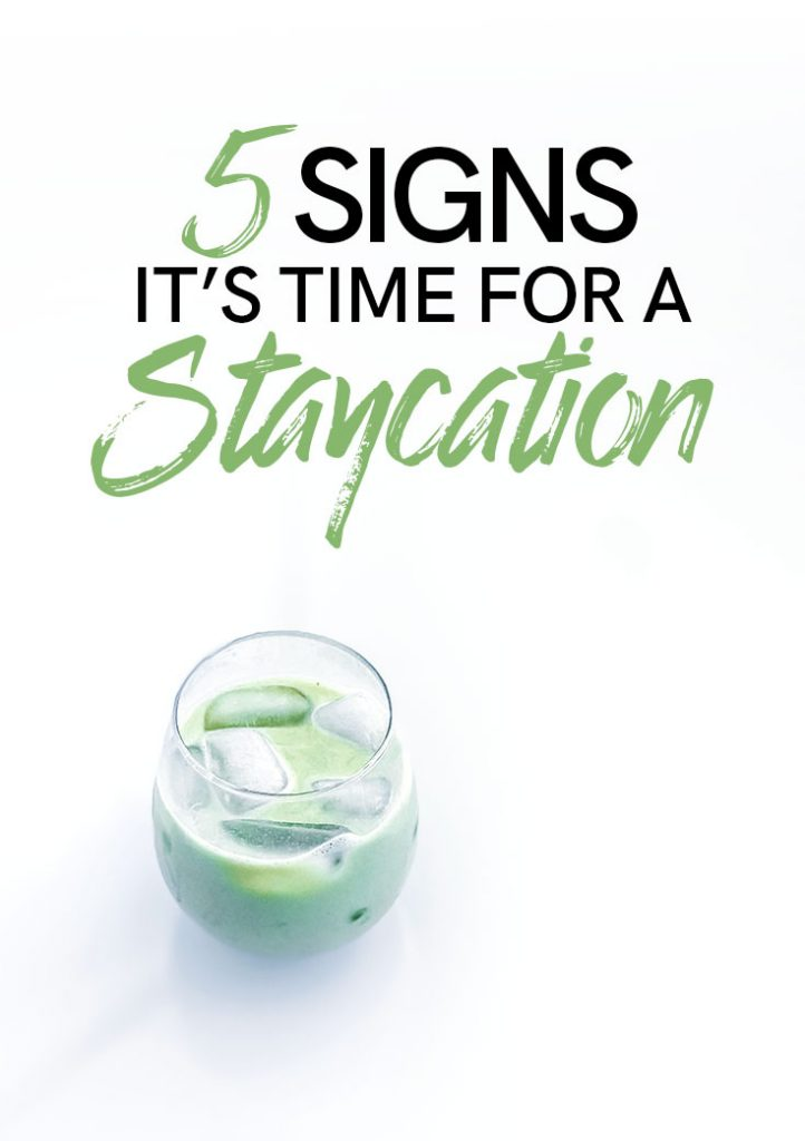 "A glass of matcha on a white table with the words ""5 Signs It's Time for a Staycation"""