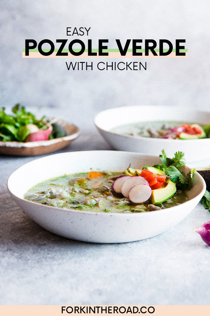 two white bowls of pozole verde chicken soup on a blue table
