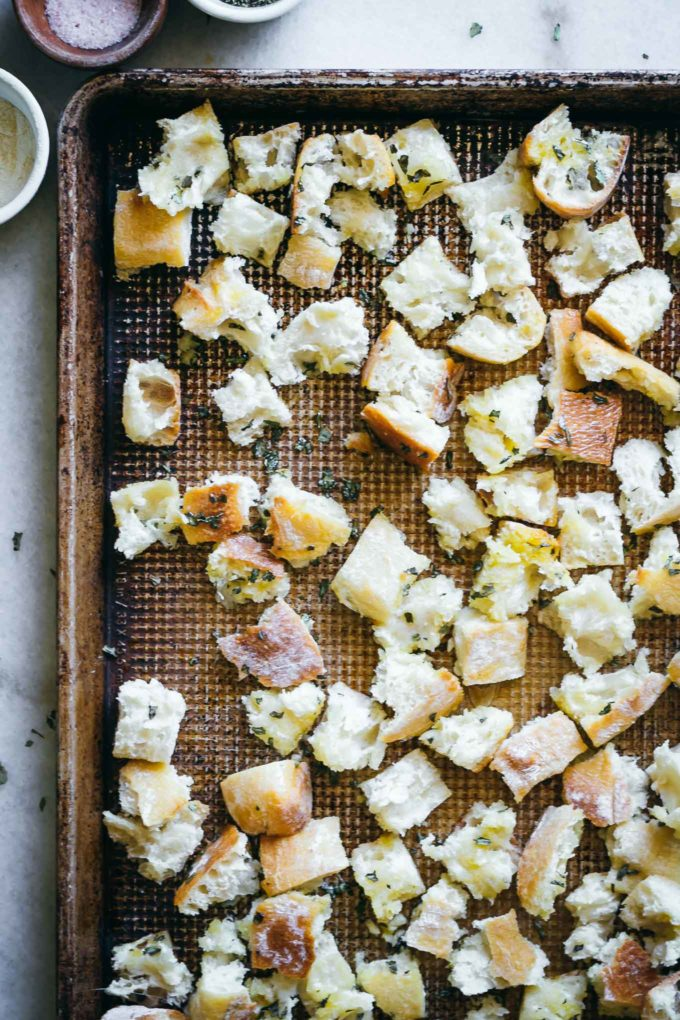 baked croutons on a baking sheet on a white table