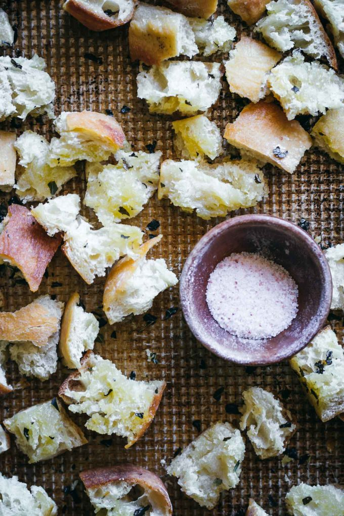 cooked ciabatta croutons on a baking sheet