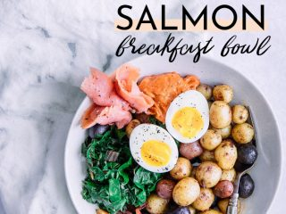 A savory breakfast bowl with soft-boiled egg, salmon, and potatoes on a white table with the words