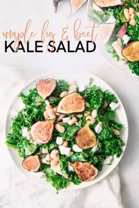 """A green kale and fig salad on a white plate with the words """"maple fig and beet kale salad"""" in black and pink writing."""