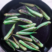 A cast iron skillet with okra.