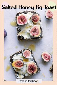 """Bread with honey and figs with the words """"salted honey fig toast"""" in black writing."""