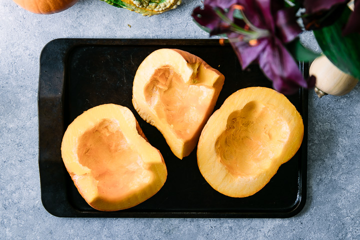 sliced pumpkins on a cookie sheet