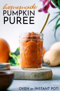 A jar of homemade pumpkin puree on a blue table