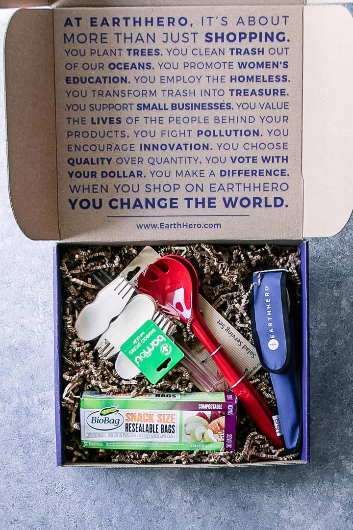 An Earth Hero box with eco-friendly kitchen tools on a blue table