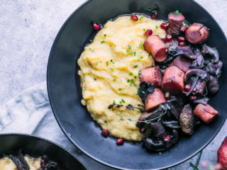 roasted mushrooms and carrots in wine sauce with cheesy polenta