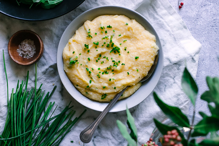 polenta with cheddar and chives on a white napkin