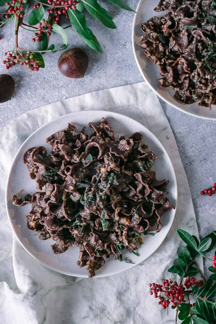 chocolate pasta noodles in a vegan chestnut creamy sauce