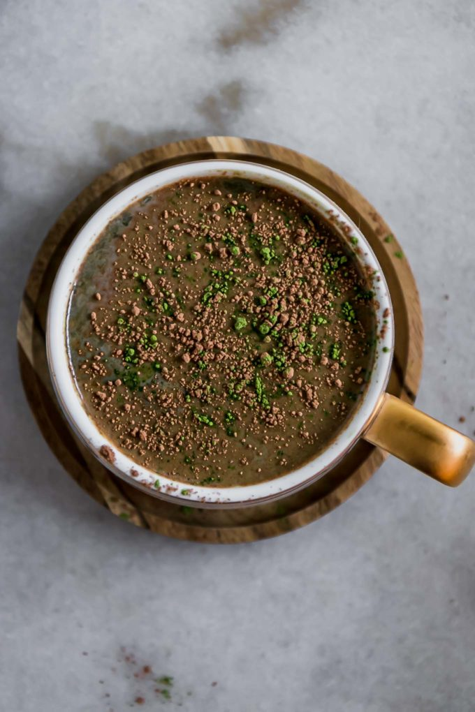 the top of a matcha latte with sprinkled cocoa powder and matcha green tea powder