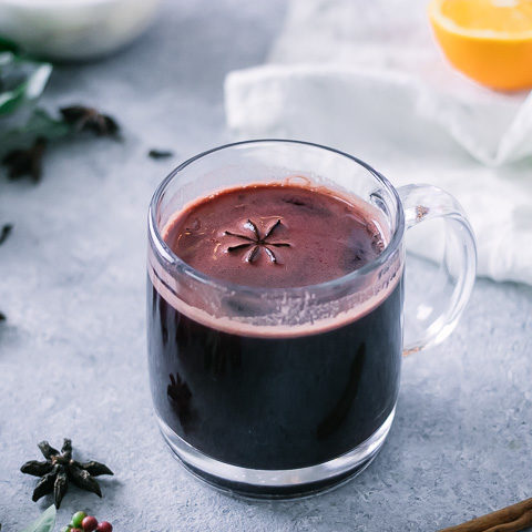 a hot mug of gluwhein on a christmas holiday table