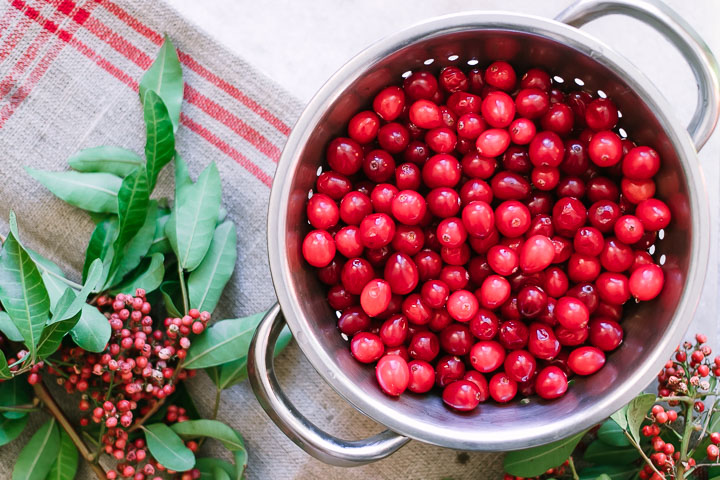 A colander with freshly washed cranberries