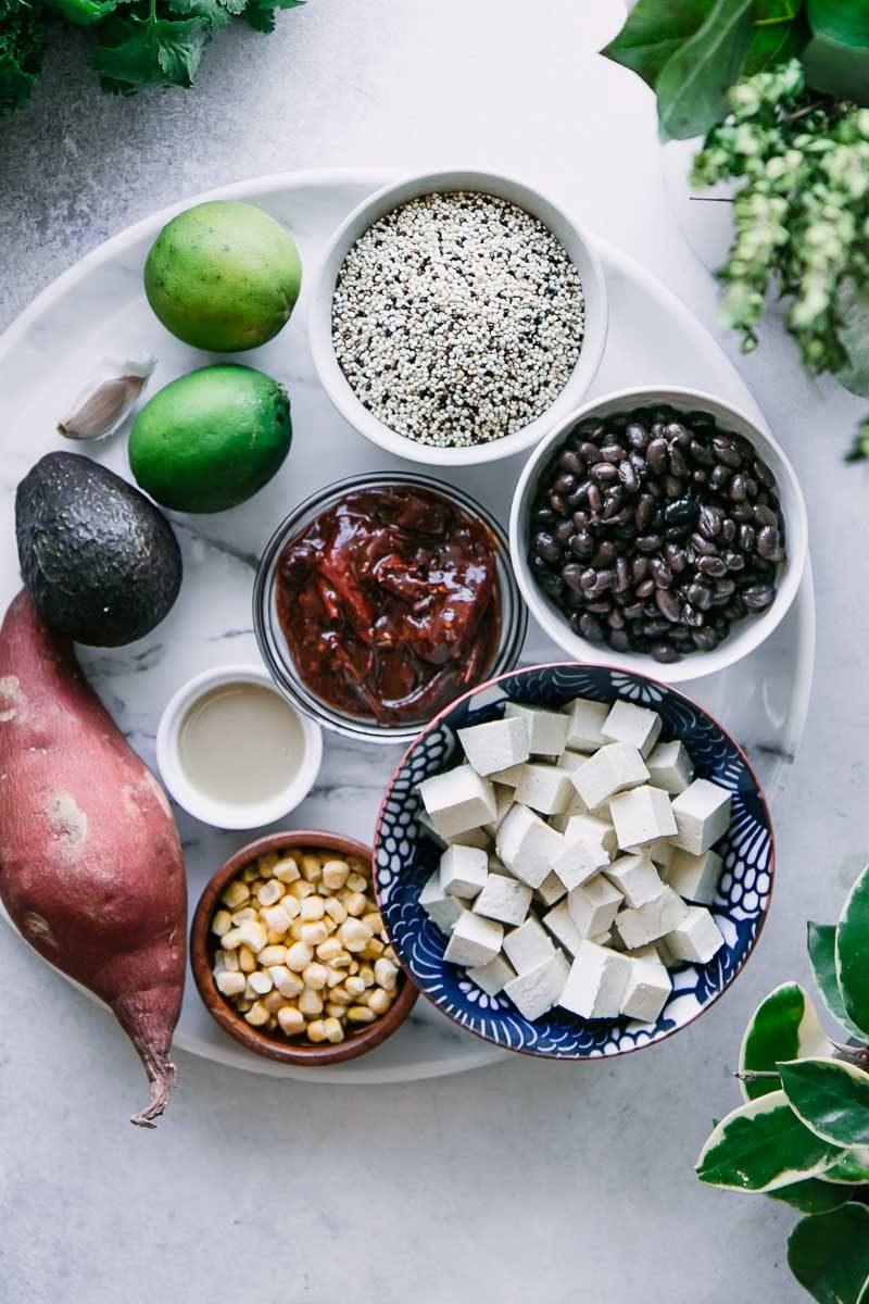 bowls of quinoa, black beans, cubed tofu,