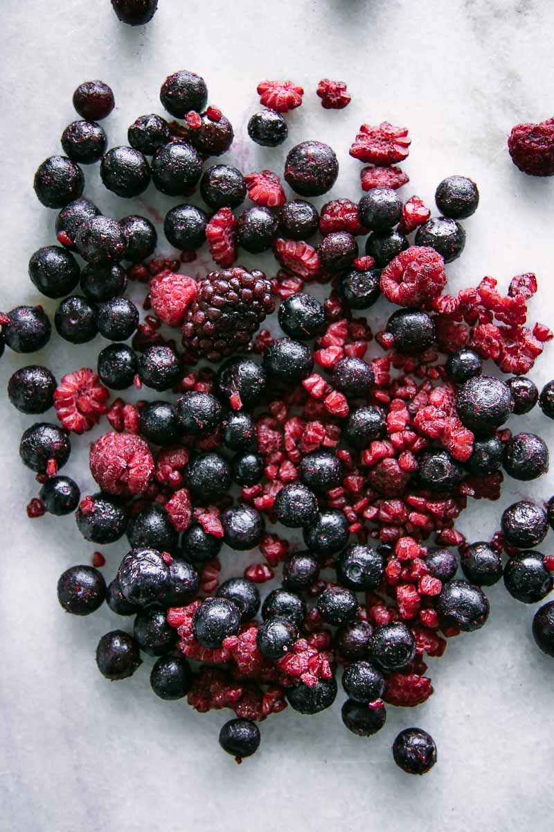 frozen blackberries, blueberries, and raspberries on a white table