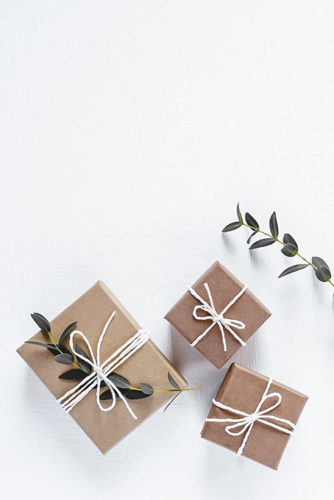 Gifts in natural gift wrap on a white table