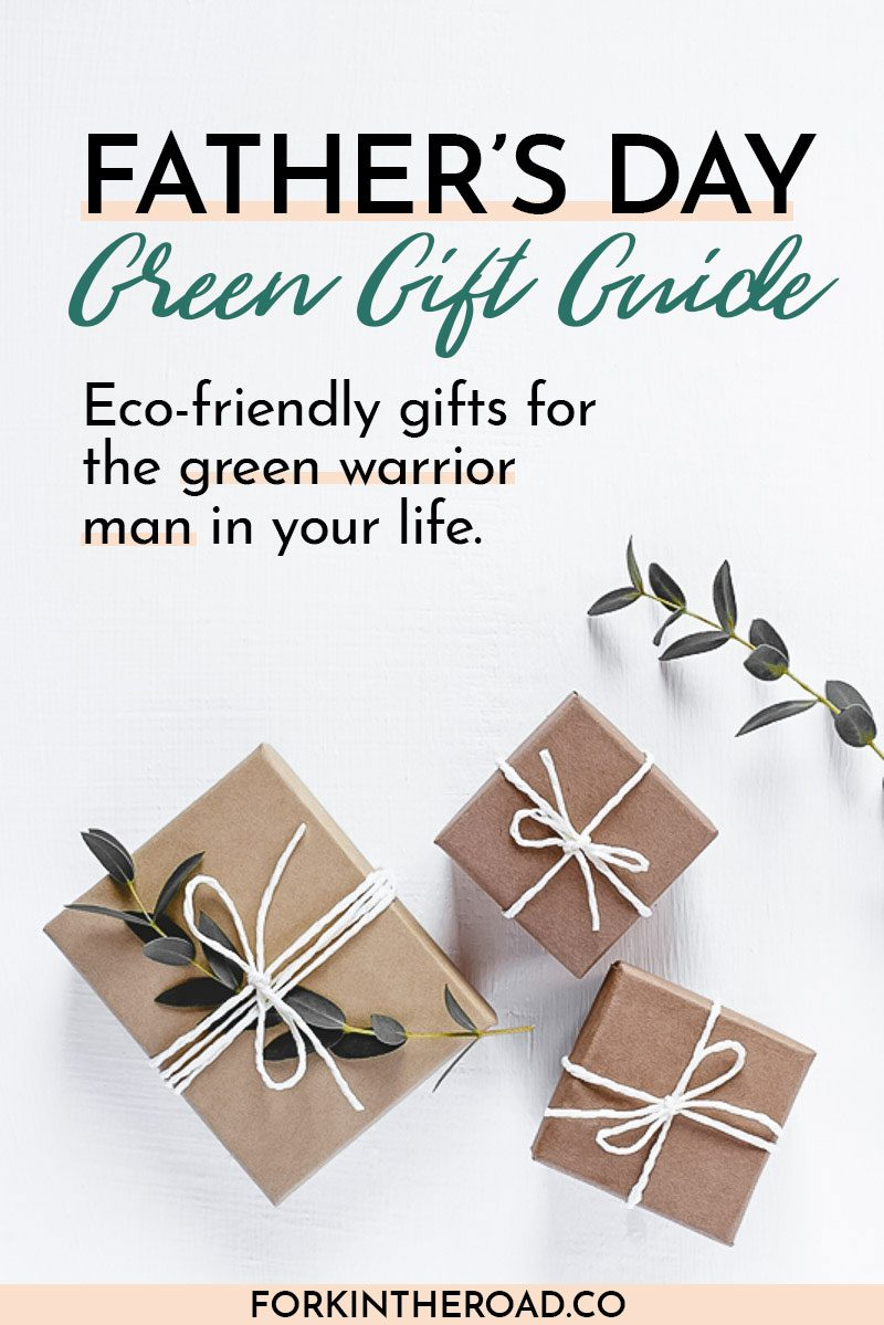 "Gifts in natural gift wrap on a white table with the words ""Father's Day Green Gift Guide"" in black writing"
