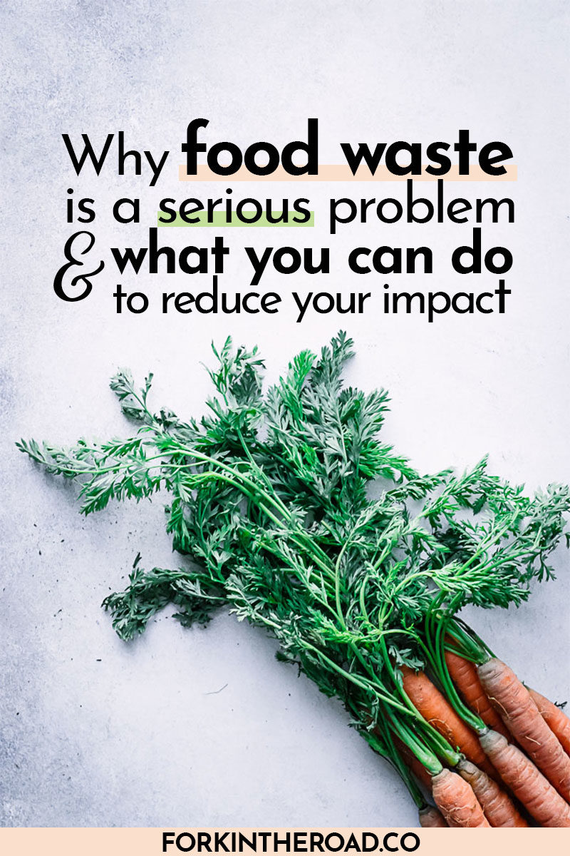 "carrot tops on a blue table with the words 'Why food waste is a serious problem and what you can do to reduce your impact"" in black writing"