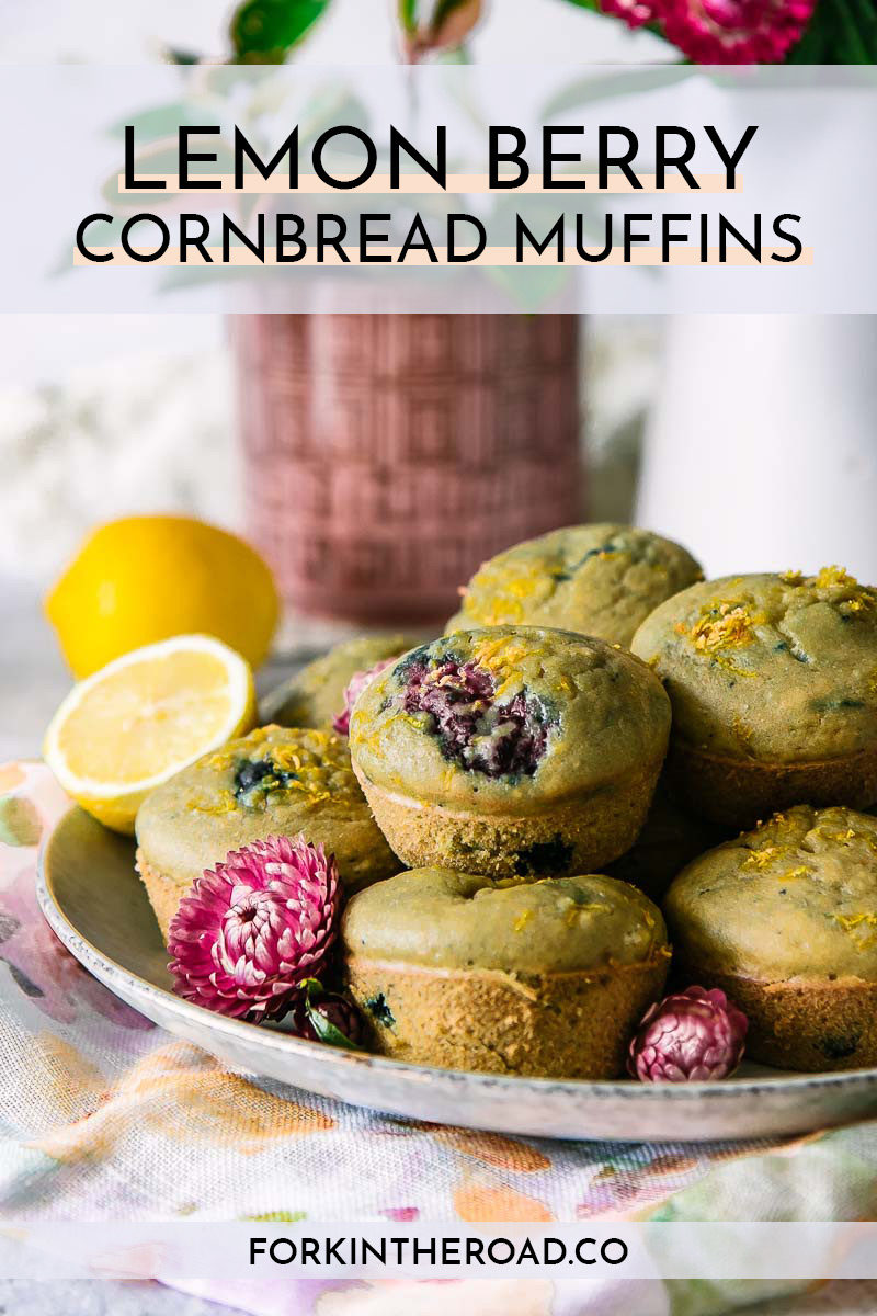 """berry muffins on a plate with the words """"lemon berry cornbread muffins"""" in black writing"""