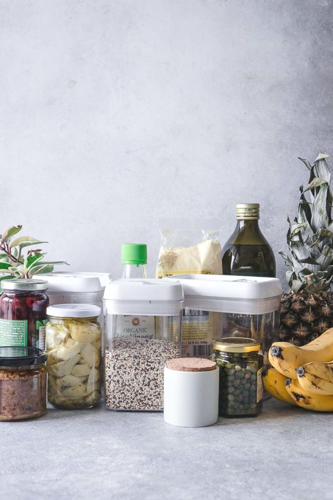 jars and boxes of food and fruit on a kitchen counter