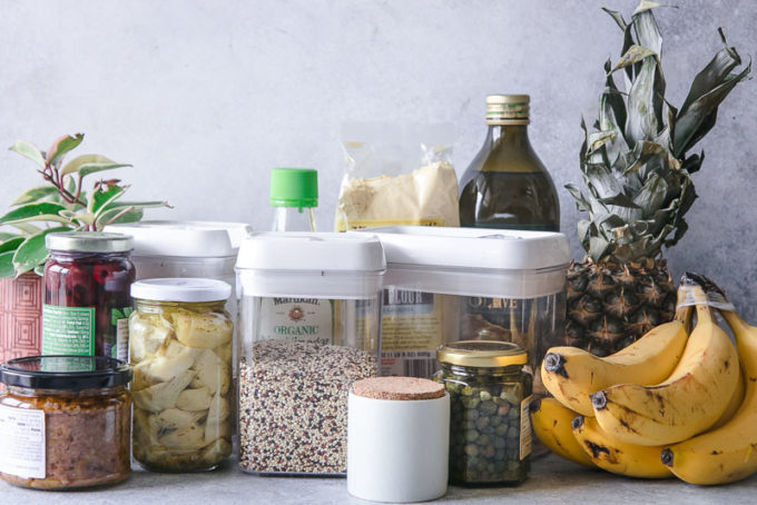 boxes and jars of food on a white countertop