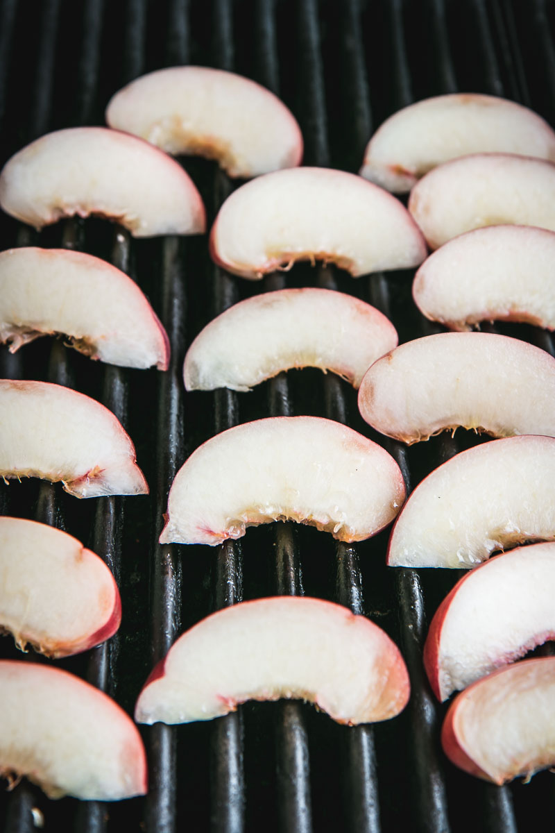 sliced peaches on a grill