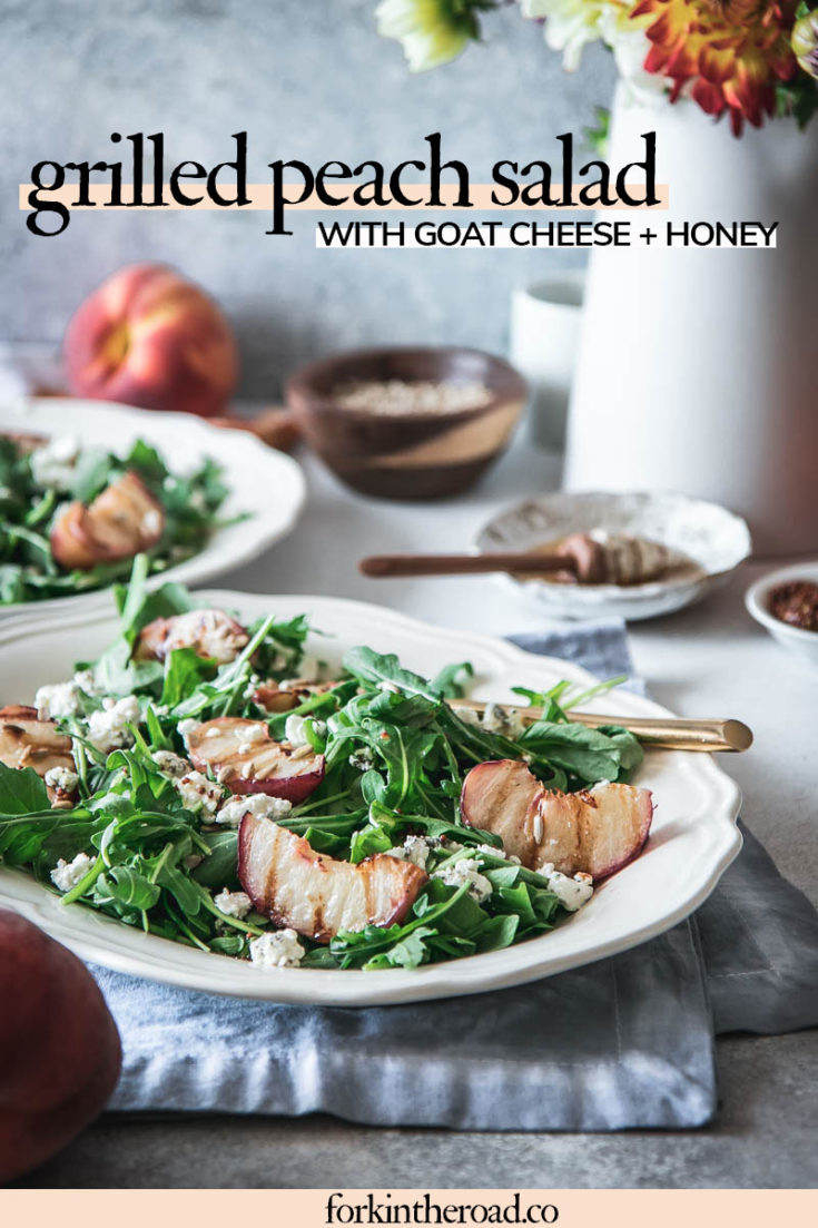 Grilled Peach Salad with savory goat cheese and a simple honey mustard dressing. The perfect way to enjoy grilled peaches this summer! | ForkInTheRoad.co | #recipe #salad #summer #peaches #grilled #goatcheese #honey #forkintheroad