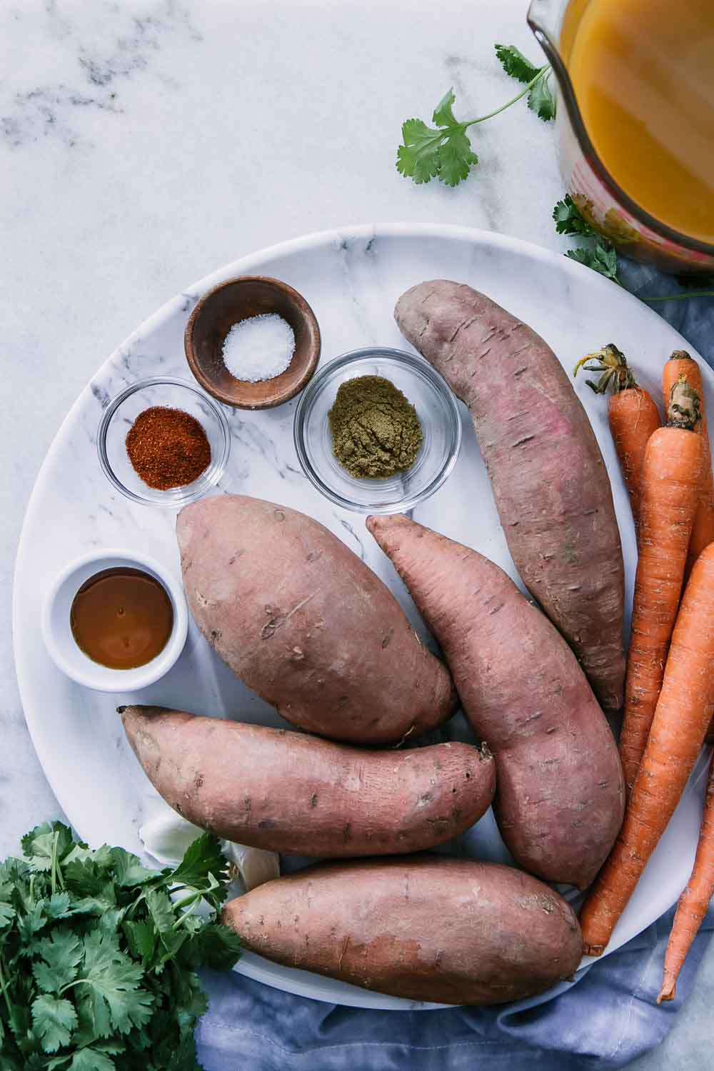 sweet potatoes, carrots, vegetable broth, spices, and herbs to make a simple instant pot sweet potato carrot soup