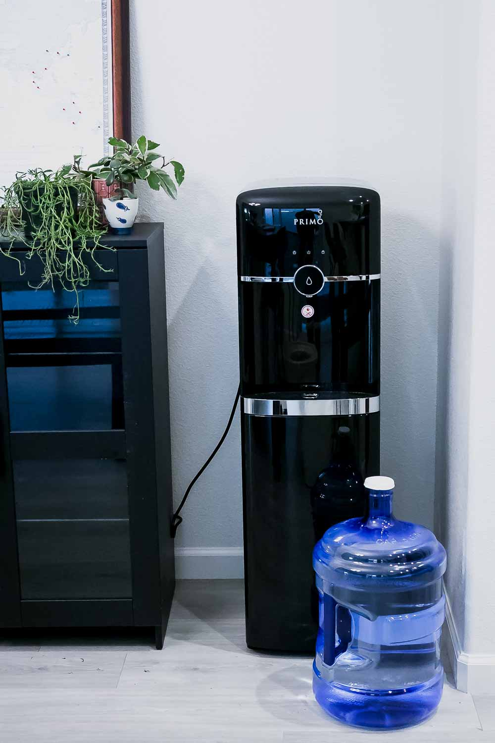 a primo water dispenser in a kitchen corner
