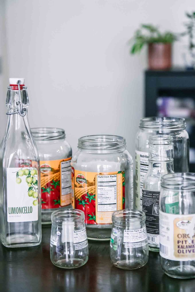 empty glass food jars with labels on a wooden table