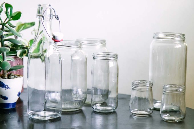 empty glass food jars on a wooden table