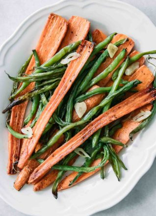 roasted green beans and carrots on a white plate