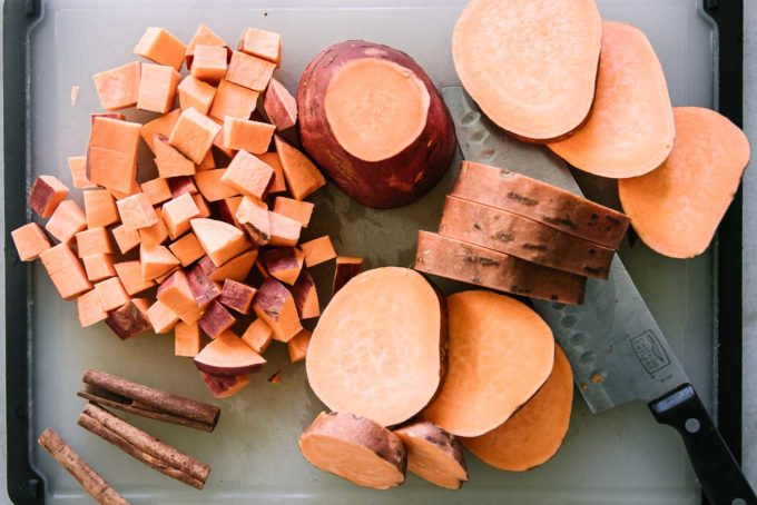 sliced and cubed sweet potatoes on a cutting board