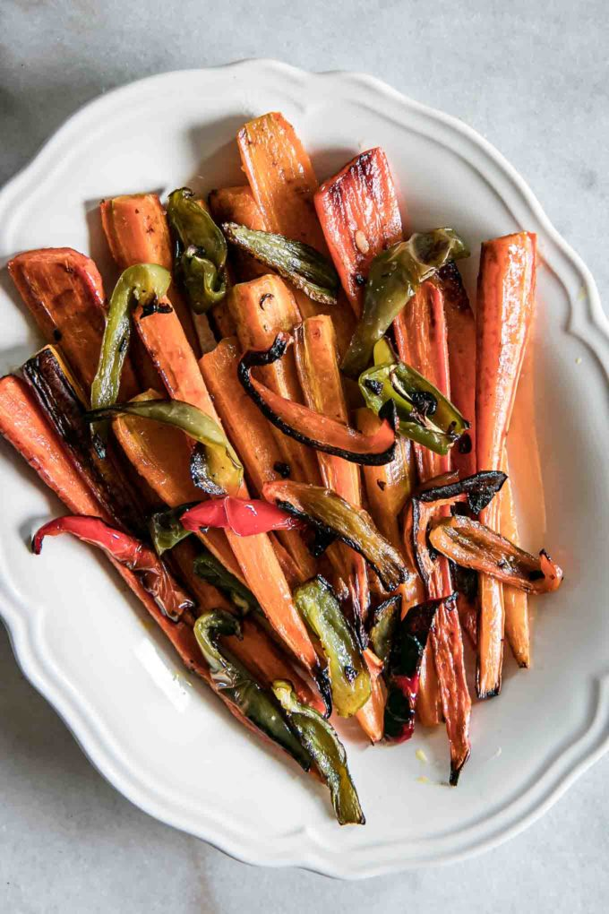 baked carrots and sweet peppers on a white plate