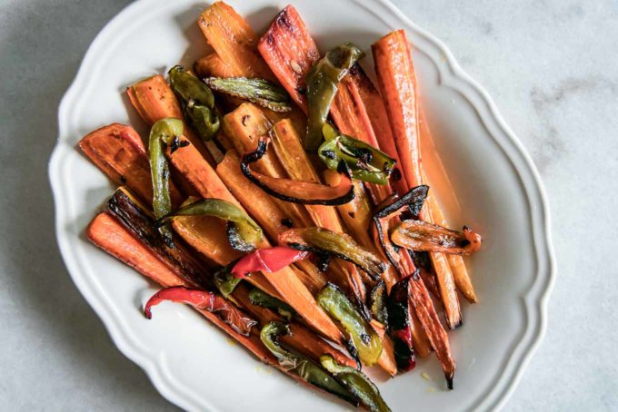 roasted carrots and bell peppers on a white plate