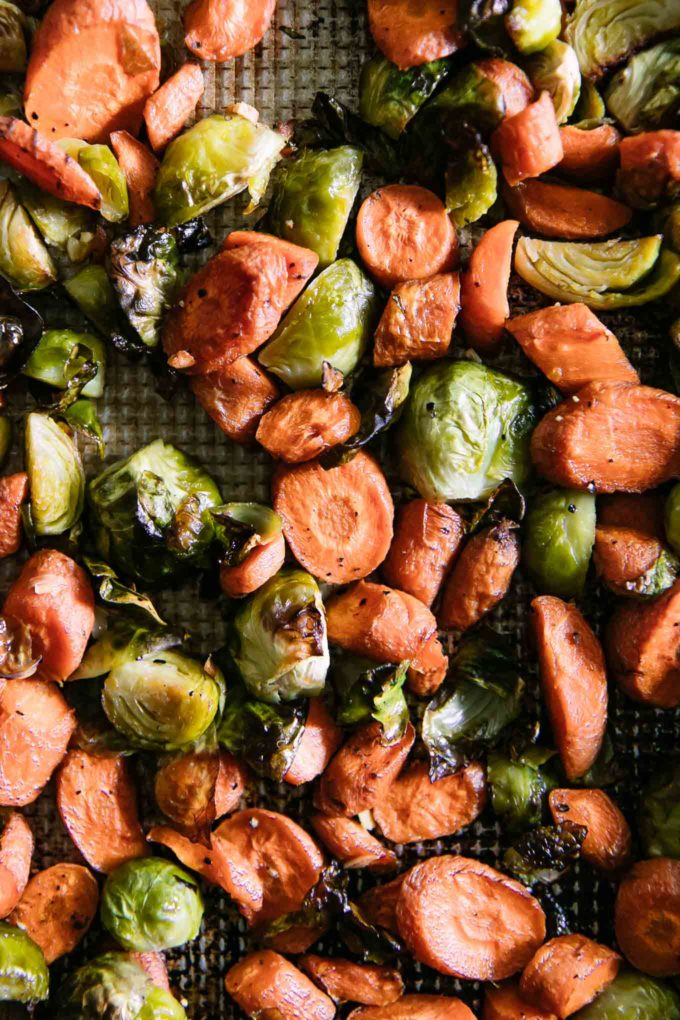 roasted brussels sprouts and carrots on a sheet pan